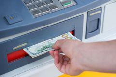Withdraw money from ATM. Taking money out of the ATM Royalty Free Stock Images