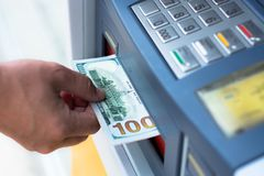 Withdraw money from ATM. Taking money out of the ATM Stock Images
