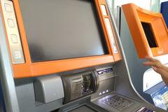 Withdraw your money ATM. Hand entering PIN numbers on ATM Stock Photos