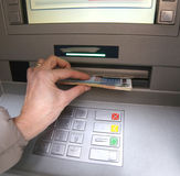 Withdrawal of money in European banknotes from ATM Stock Photos