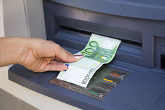Withdrawal money out of ATM Stock Image