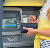 Withdrawing money from an ATM. Stock Photography