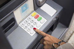 Withdrawing money at atm Stock Photography
