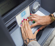 Withdrawing money at atm Royalty Free Stock Photo