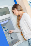 Withdrawing money from cash machine. Withdrawing money from a cash machine Royalty Free Stock Photography