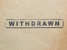 Withdrawn. Stamp on a book page Royalty Free Stock Photo