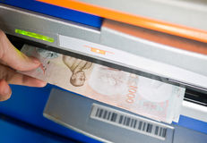 Withdrawn money from ATM. A male hand holding withdrawn money from ATM Royalty Free Stock Image