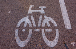 Withe bike signal on asphalt. Withe bike signal on black asphalt and sunny day Royalty Free Stock Images