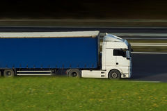 Withe and blue semi truck royalty free stock photo
