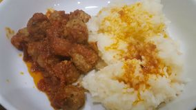 A withe plate with rice and meatballs. A withe plate with withe rice and meatballs for dinner Stock Image