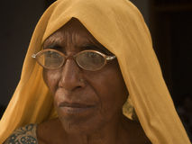 Withered with age,looking into her past. This picture was taken in a small village in Uttar Pradesh, India Stock Photo