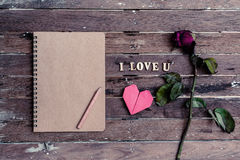 Withered rose and red heart shape Stock Image