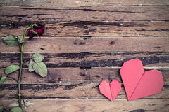 Withered rose and red heart shape Stock Photo