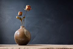 Withered rose in vase Stock Images