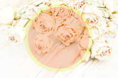 Withered rose on wooden background Royalty Free Stock Photo