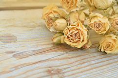 Withered rose on wooden background Royalty Free Stock Image
