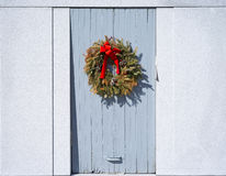 Withering wreath on door Stock Photography