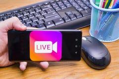 WithInstagram Live Stream do telefone celular fotos de stock