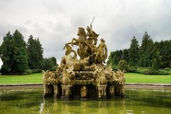 Witley Court garden fountain. Witley Court fountain with statue. Green grass at background Stock Images