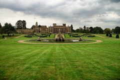 Witley Court garden with fountain. Dramatic sky. Green grass Stock Photo