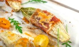 Witlof with prosciutto and  mozzarella Stock Photo
