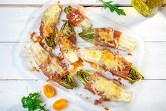 Witlof with prosciutto and  mozzarella Stock Images