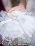 Witness holding white cushion with wedding rings Royalty Free Stock Photography