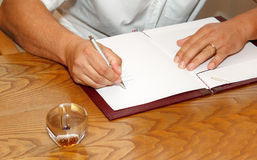 Witness signing wedding contract Royalty Free Stock Image