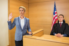 Witness taking an oath Royalty Free Stock Image