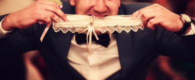 Witness and wedding garter Stock Image