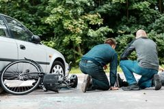Witnesses of road collision helping stock photo