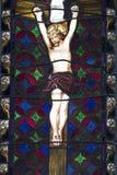 Witraż nadokienny pokazuje Chrystus na krzyżu Obraz Royalty Free