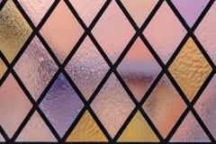 Witraż z wielo- barwionym diamentu wzorem jako tło Zdjęcia Royalty Free