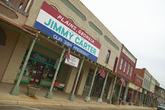 Witryna sklepowa z sztandarem krzyczy równiny Gruzja być domem Jimmy Carter, nasz 39th prezydent w równinach, Gruzja Fotografia Stock