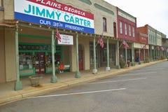 Witryna sklepowa z sztandarem krzyczy równiny Gruzja być domem Jimmy Carter, nasz 39th prezydent w równinach, Gruzja Zdjęcia Stock