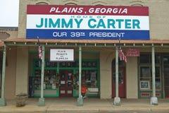 Witryna sklepowa z sztandarem krzyczy równiny Gruzja być domem Jimmy Carter, nasz 39th prezydent w równinach, Gruzja Obrazy Royalty Free