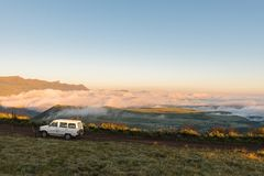 Sunrise on the road to the Sentinel car park. WITSIESHOEK, SOUTH AFRICA - MARCH 13, 2018: Sunrise on the road to the Sentinel car park in the Drakensberg with Stock Photography