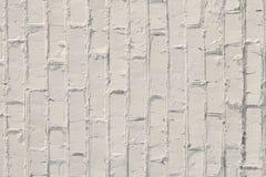 Witte achtergrond De textuur van een bakstenen muur die met witte verf wordt geschilderd stock afbeelding