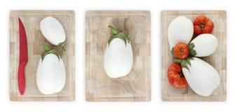 Witte aubergines en tomaten op houten scherpe geïsoleerde raad Royalty-vrije Stock Fotografie