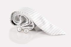 Witte band met manchetknopen Stock Foto
