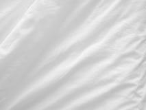 Witte bedbladen Stock Foto