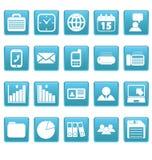 Witte bedrijfspictogrammen op blauwe vierkanten Stock Foto