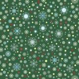 Witte blauwe gele sneeuwvlokken met rode en gele sterren op groene achtergrond Royalty-vrije Stock Fotografie