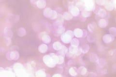 Witte bokeh op roze schaduw Royalty-vrije Stock Foto's