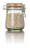 Witte bonen in een kruik stock afbeelding