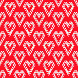 Witte die hartvormen door driehoeken naadloos patroon worden gemaakt op rode vec Stock Foto