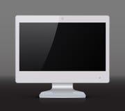 Witte die monitor op donkere achtergrond wordt geïsoleerd Royalty-vrije Stock Afbeeldingen