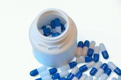 Witte en blauwe capsules stock foto