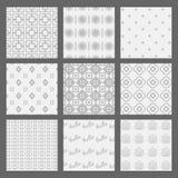 Witte en grijze geometrische en Art Deco-geplaatste patronen stock illustratie