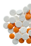 Witte en oranje pillen Stock Afbeeldingen